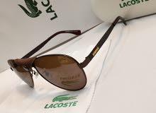 نظارة ماركة لاكوست مع جميع الملحقات