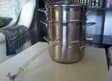 Cooking pot juice maker