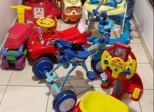 عربة اطفال ومقعد سياره ومجموعة العاب