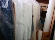 ثياب مفصلة جاهزة للبيع