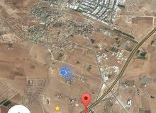 للبيع ارض 16.7 دونم في رجم الشامي على شارع الميه مباشره