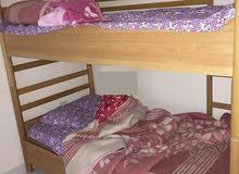 سرير طابقين زان مستعمل بحالة جيدة وسعر مغري 80000