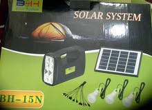 الطاقة الشمسية انارة وشاحن جوال و كشاف