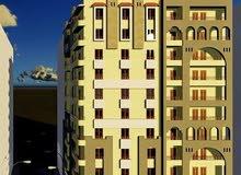 شقة 95م من المالك برج اللوتس باسيوط جاري العمل بالموقع بمقدم 20 الف و 10 سنوات تقسيط