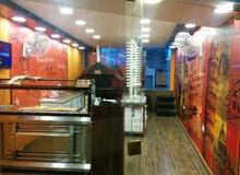 مطعم بيتزا و معجنات و سناكات للبيع بدون خلو